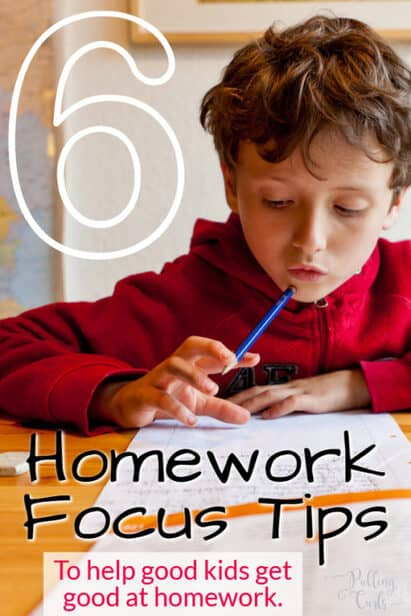 child focusing on homework